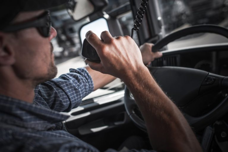 Truck driver using a radio