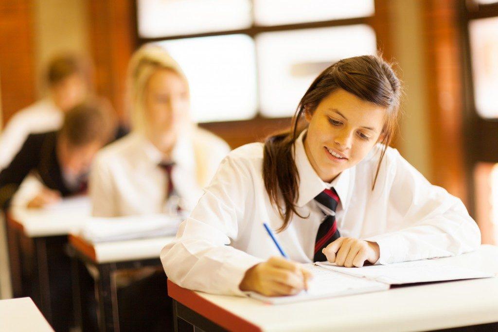 a high school student attending a class