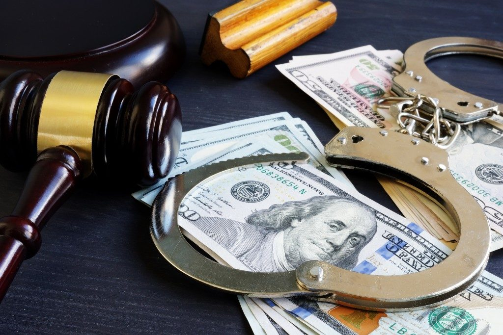 gavel, money, and handcuffs