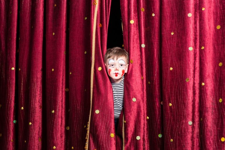 little boy behind the curtain