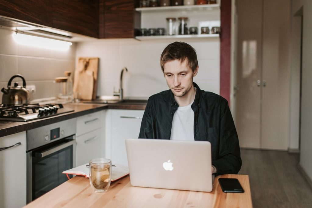 man working from home in the kitchen