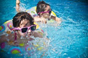 2 children swimming